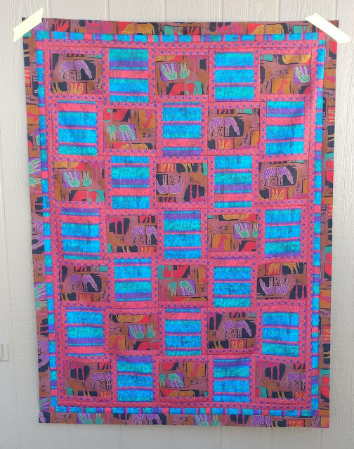An ugly quilt made with vintage fabrics for an ugly quilt challenge