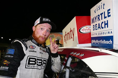Tyler Reddick, Driver of the #42 BBR/Jason Aldean Chevrolet, Celebrates in Kentucky Speedway's Victory Lane with the Winner's Decal.