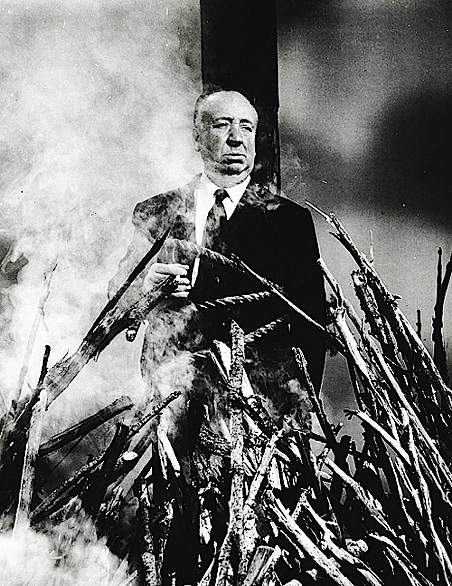 a funny photograph of film director Alfred Hitchcock being burned at the stake