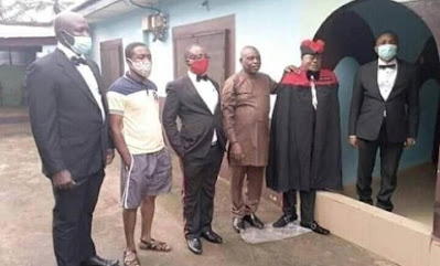 Confusion, As Family Members Take Pictures With A Standing Corpse (Disturbing Photos)