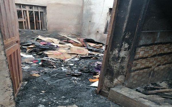 burnt down apartment where the woman and her 3 children where burnt