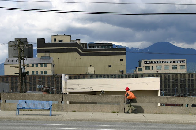 Hastings Street, The British Columbia Sugar Refining Co, and the mountains.