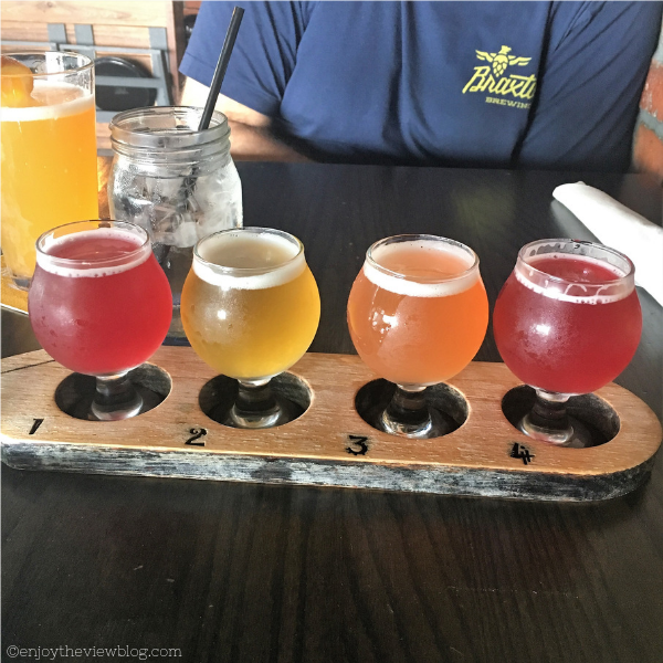 four small snifters of different fruit beer