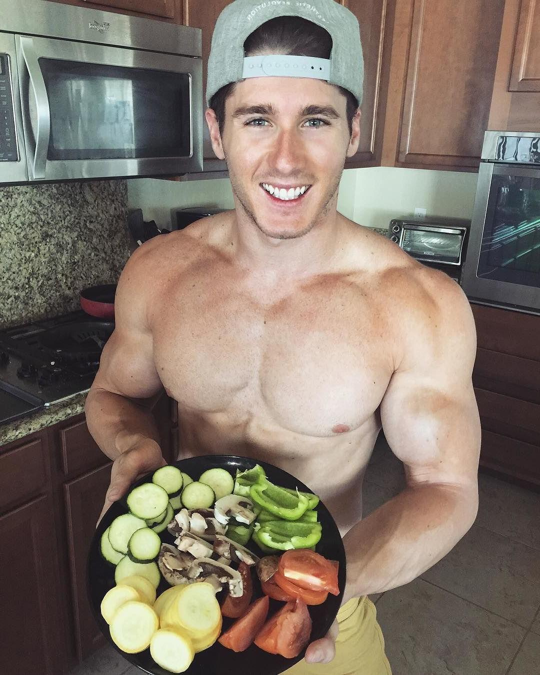 fit-shirtless-dude-baseball-cap-beautiful-blue-eyes-smiling-healthy-food-vegetables