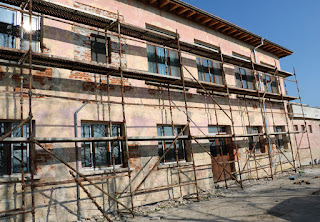 The scaffold runs all along the front of the building