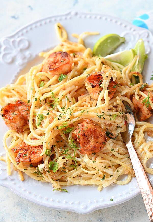 a white plate with best bang bang shrimp pasta