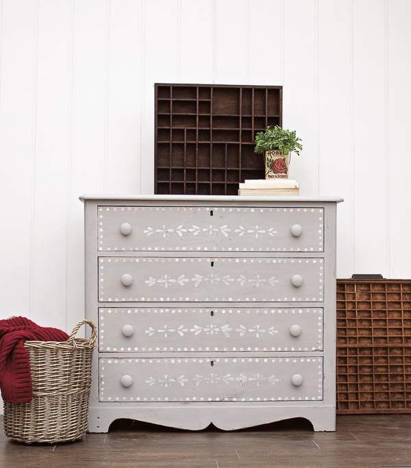 gray dresser with stenciled drawers