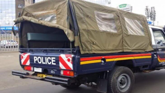 Police car taking Wesley Mutai, 40, from Bandiat Village