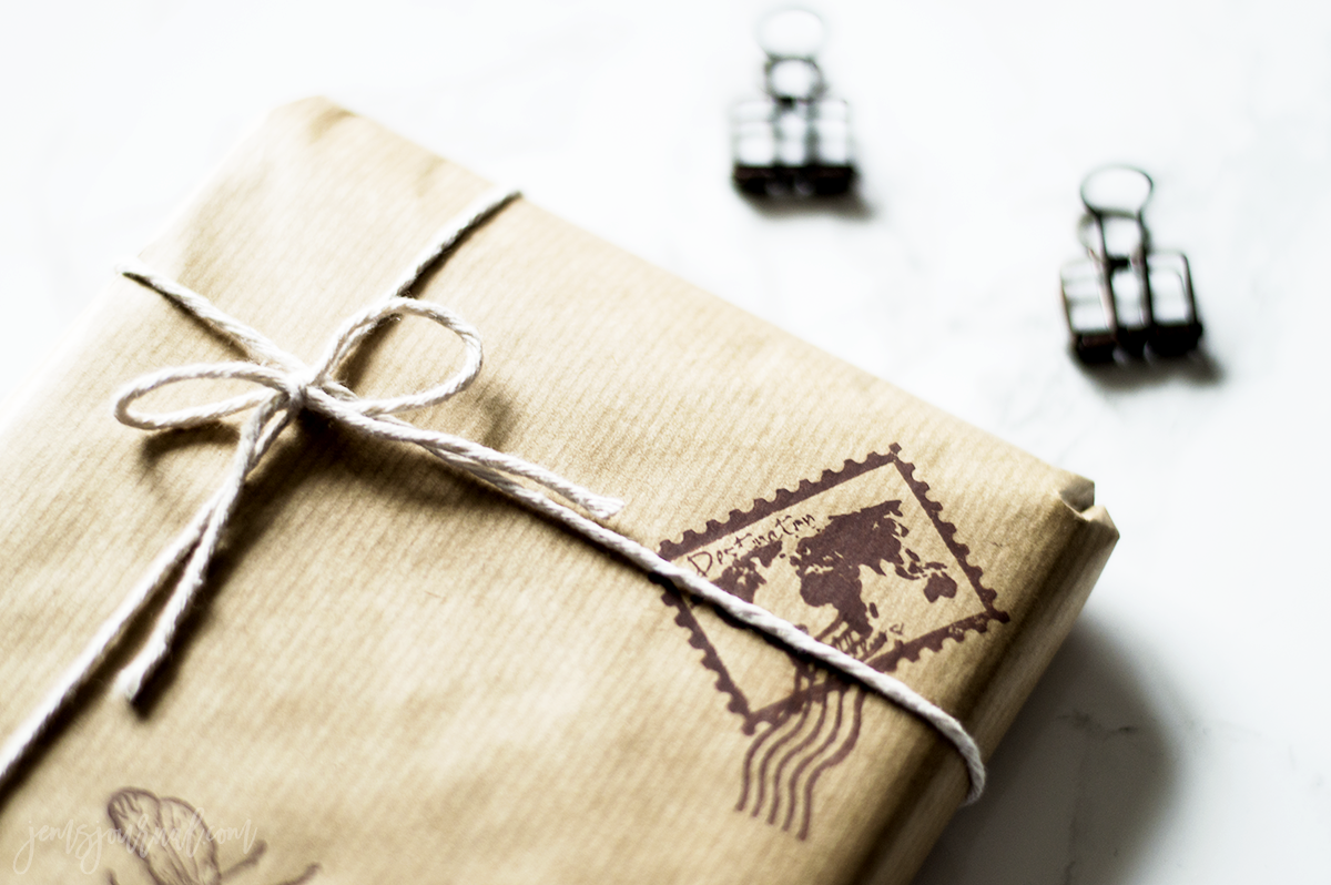 vintage brown paper package with string and stamps