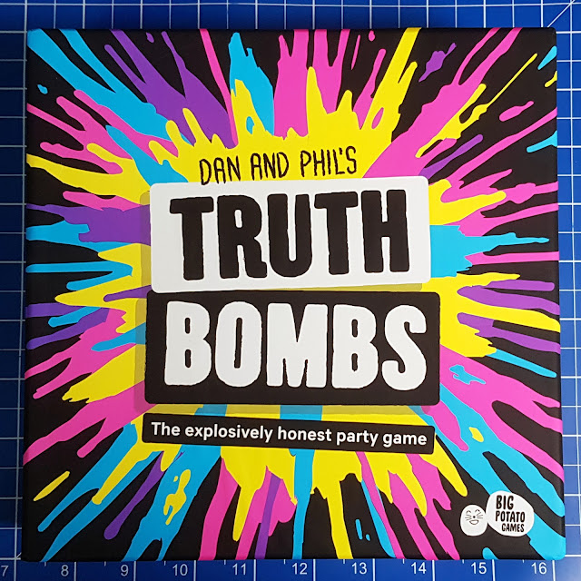 Truth Bombs Party Game Review front of box with colourful explosion