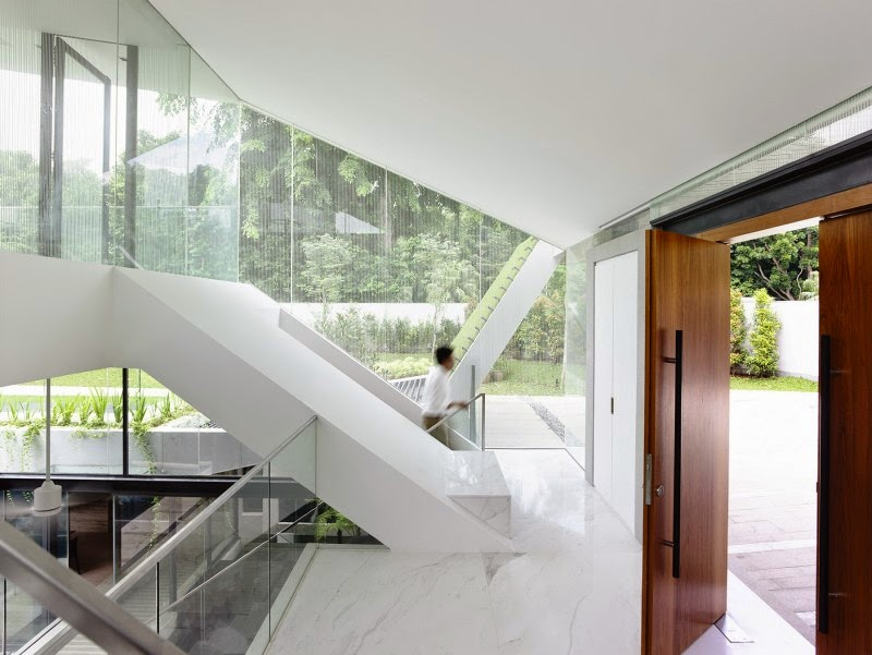 Singapore Contemporary House - interior design - slopping wall and stairs with natural light coming from large glass wall