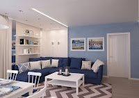 White coffee, table blue sofa with cushions, and chevron rug