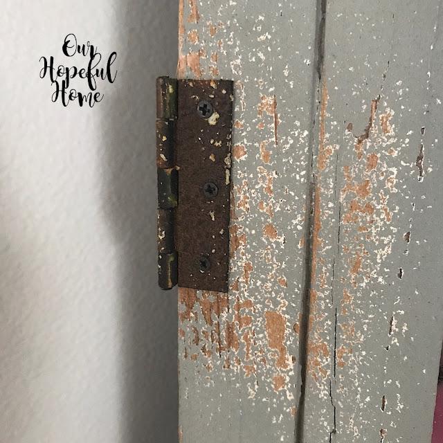 chippy paint rusty hinge door