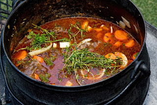 Potjiekos (Pot = potjie and Food =kos) is a traditional Southern African Afrikaner stew cooked in a cast iron pot over an open fire.