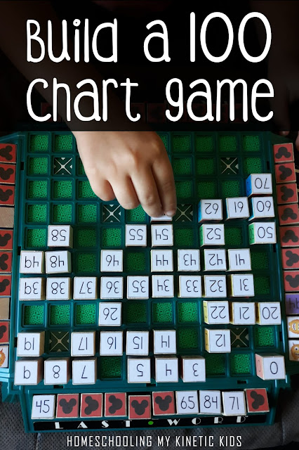 girl playing game on 100 chart board