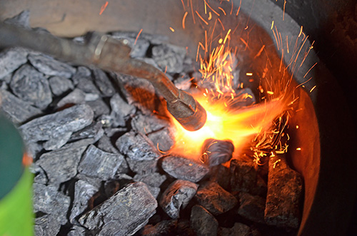 Lighting a kamado grill with a JJ George Grill Torch