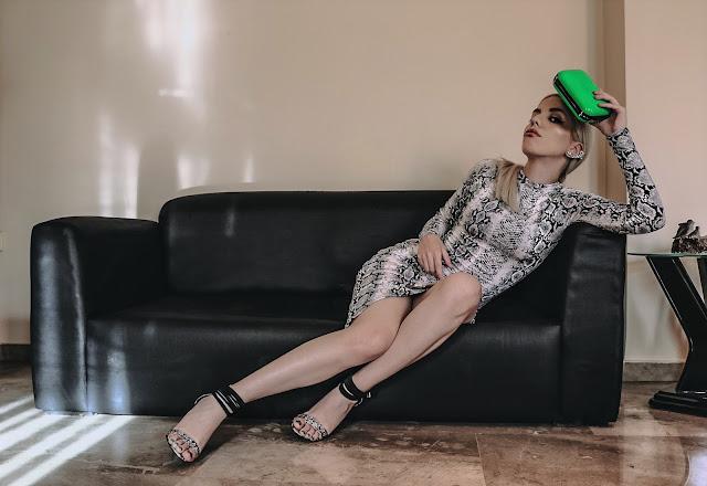 neon clutch, snake print dress and heels