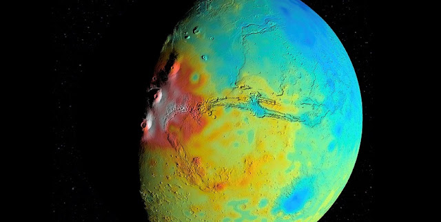 A new map of the thickness of Mars' crust shows less variation between thicker regions (red) and thinner regions (blue), compared to earlier mapping. This view is centered on Valles Marineris, with the Tharsis Montes near the terminator to its west. The map is based on modeling of the Red Planet's gravity field by scientists at NASA's Goddard Space Flight Center in Greenbelt, Maryland. The team found that globally Mars' crust is less dense, on average, than previously thought, which implies smaller variations in crustal thickness. Credits: NASA/Goddard/UMBC/MIT/E. Mazarico