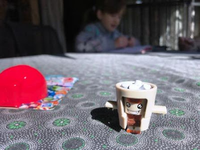 Transformer BotBot Cocoa Crazy on table with girl in background