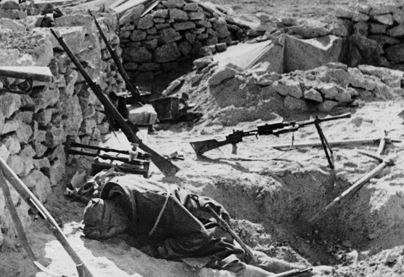 The body of an Italian soldier lies where he fell during battle, in a stone-walled fort somewhere in the West Libyan desert, on Febrary 11, 1941.