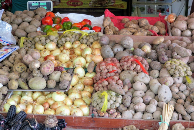 Potatoes and other root vegetables at San Isidro Mercado in Lima Peru.