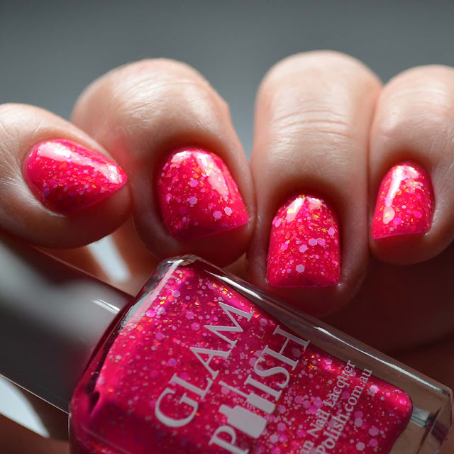 pink nail polish with glitter low light swatch