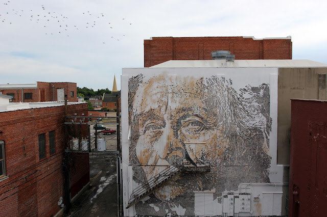 Vhils is the second artist to complete his mural in Downtown Fort Smith for the first edition of the excellent Unexpected Street Art Festival which is curated by JustKids.