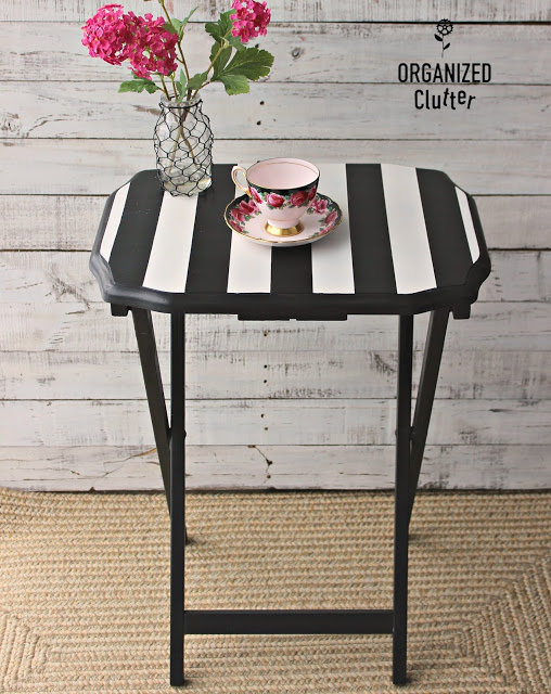 Photo of folding tray upcycled in black with white stripes