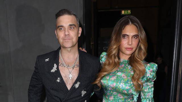 Amenazaron con decapitar a Robbie Williams y a su esposa durante un viaje humanitario a Haití en 2010