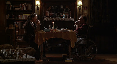 Misery 1990 movie scene where Kathy Bates's Annie Wilkes and James Caan's wheelchair-bound Paul Sheldon enjoy a lovely candelit dinner together