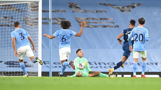 Arsenal forward Aubameyang beats Man City goal keeper Ederson