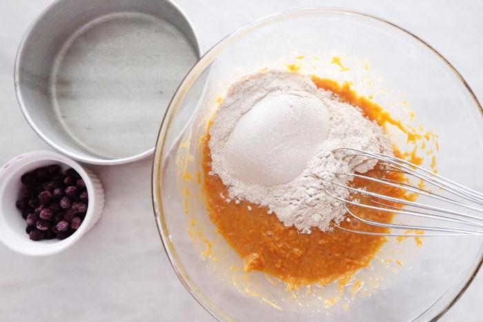 adding dry ingredients to bowl