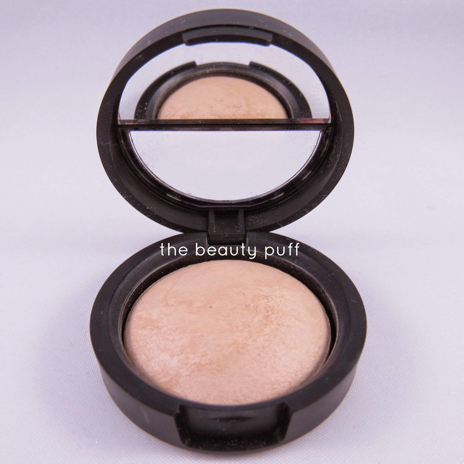 laura geller french vanilla highlight - the beauty puff