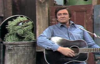 Johnny Cash sings Nasty Dan for Oscar The Grouch. Sesame Street Best of Friends