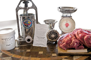 Supplies for making Polish sausages: pork butt, meat grinder & more