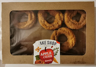 A box of Bake Shop Bakery Apple Cider Donuts with two donuts missing