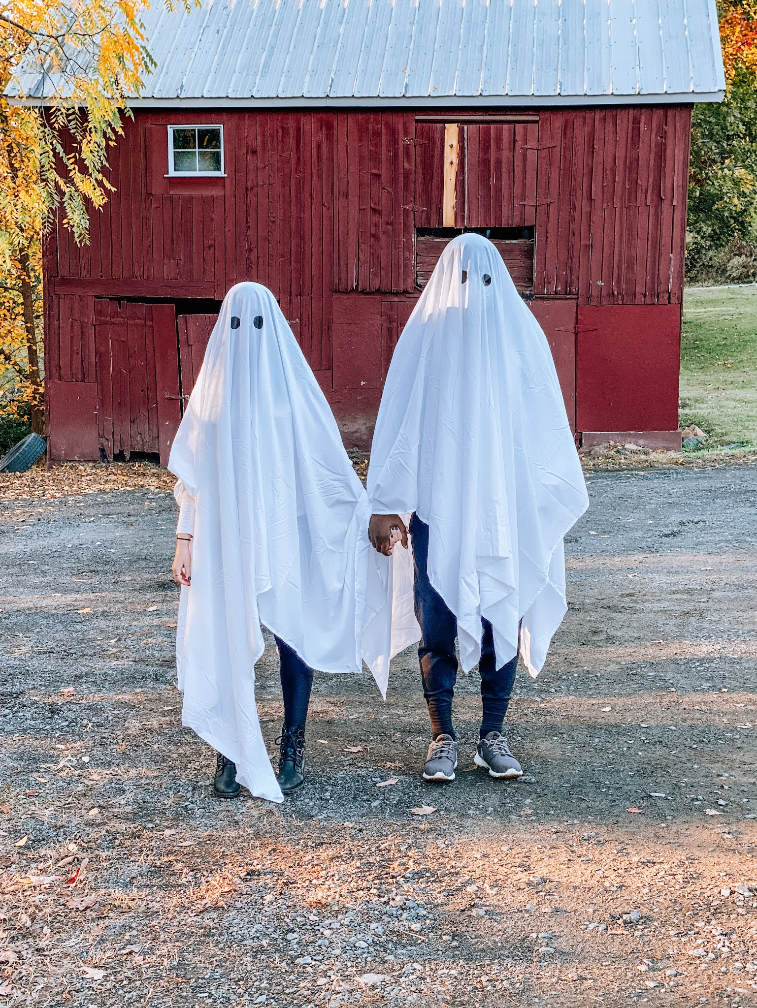 Fashion blogger Kathleen Harper dressed as a ghost for a Halloween photo shoot.