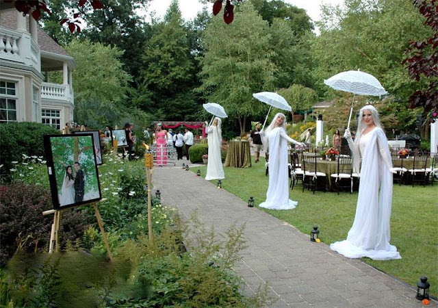 K'Mich Weddings - wedding planning - entrance decor - Strolling Tables - live statues in white dresses