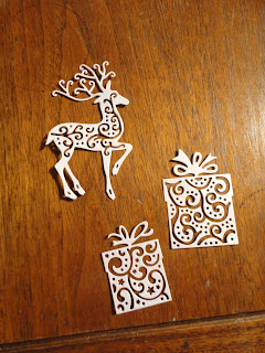Reindeer and present die cuts in hint of gold Centura Pearl