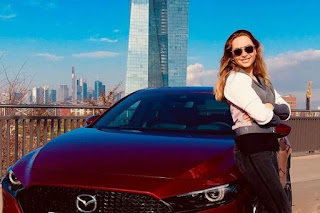 Sophia Florsch posing for picture with car