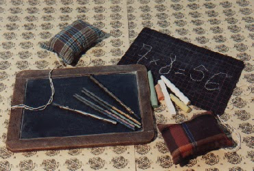 Ardoise traditionnelle et ardoise en carton