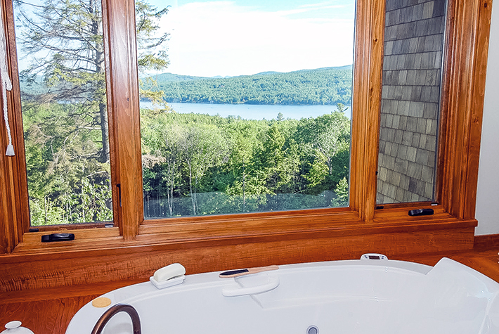 bathtub with a view of Pleasant lake NH