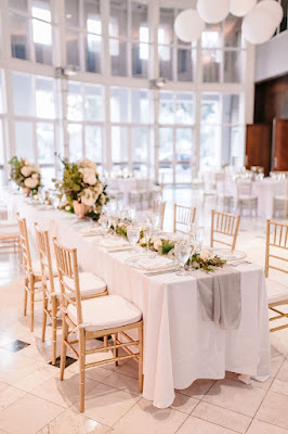 wedding reception long table with flowers