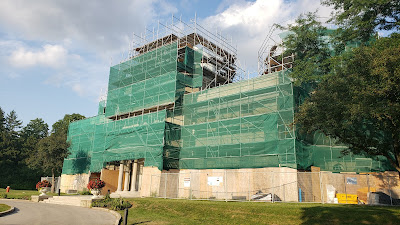 DDO admin building surrounded by scaffolds