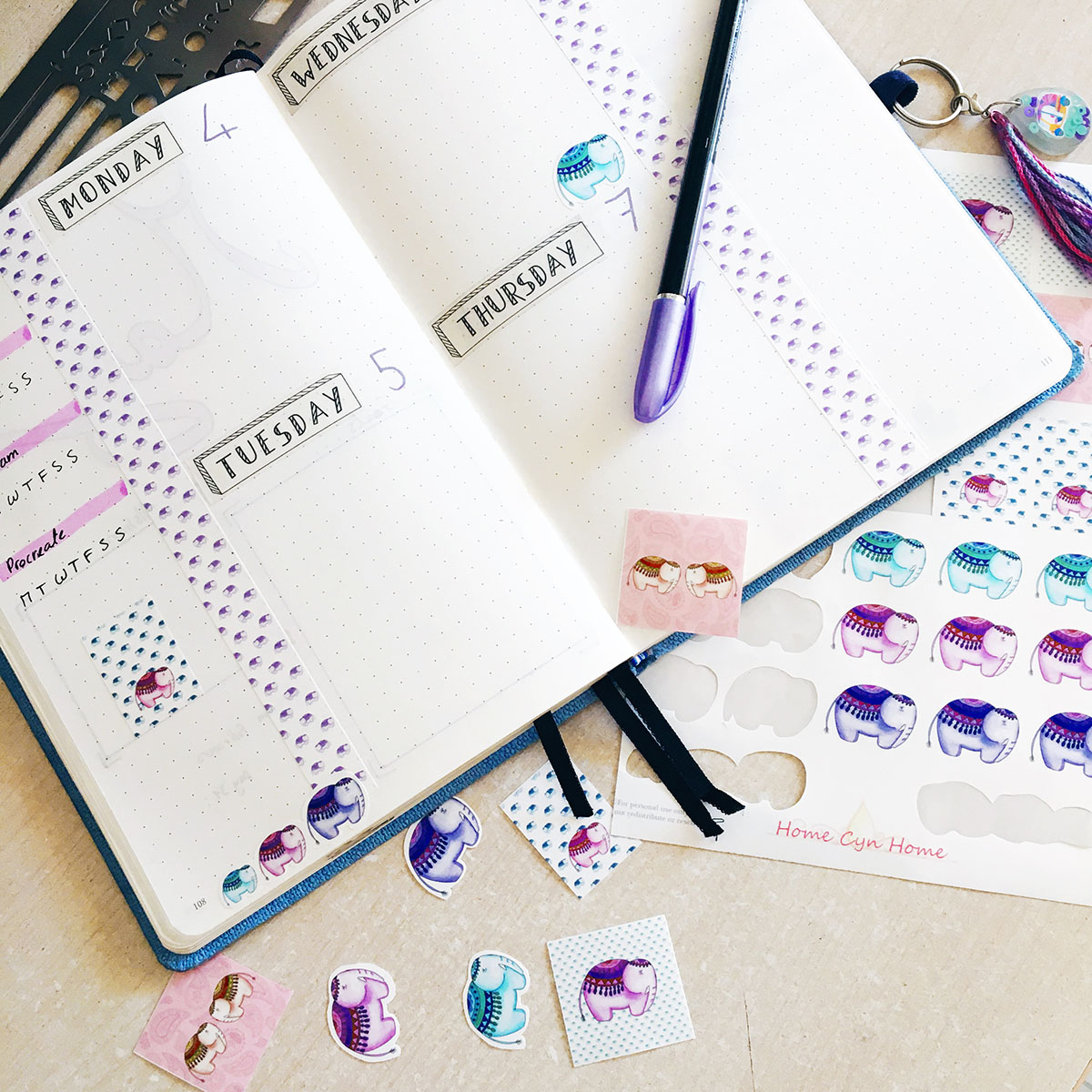 A bullet journal spread with Home Cyn Home printable stickers