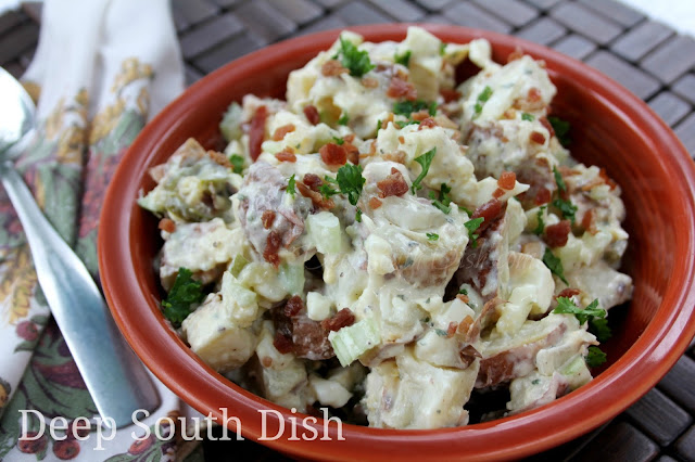 Small red potatoes are first baked, then chopped or sliced and tossed with bacon and onion in a mayonnaise, vinegar and ranch dressing seasoning.