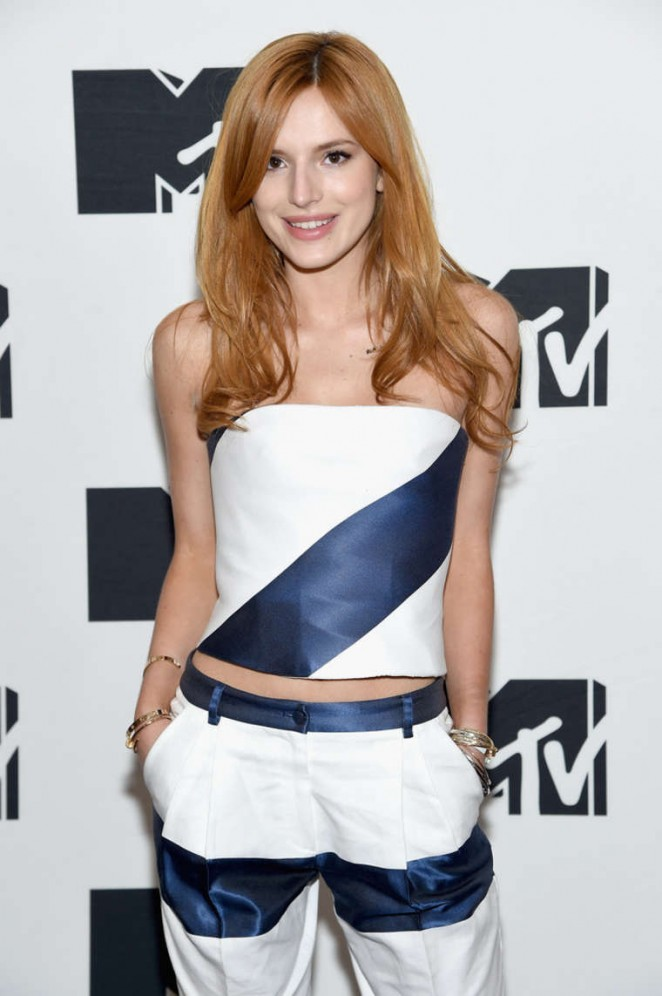 Bella Thorne in a strapless cropped top and trousers at the 2015 MTV Upfront Presentation in NYC