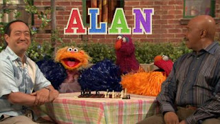 Gordon and Alan play chess, Elmo, Zoe and Telly begin cheering for Alan. Sesame Street Episode 4420, Three Cheers for Us, Season 44