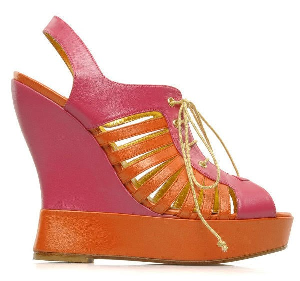 stock photo of orange and pink wedge shoes on white background from side