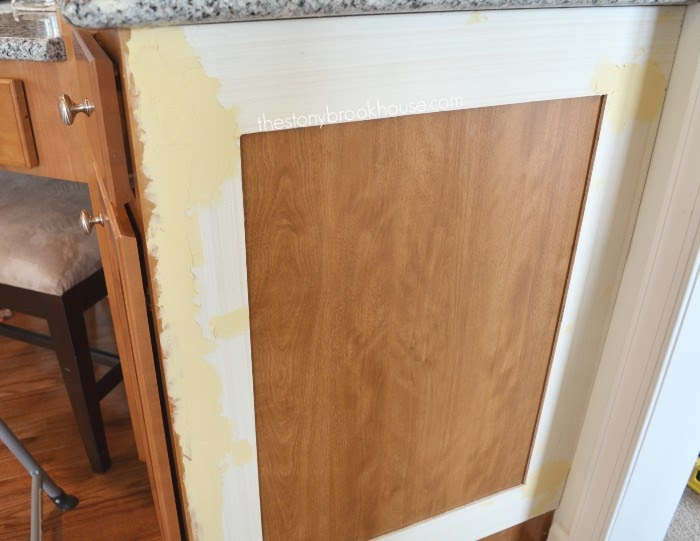 Wood filler on side cabinet to make flush